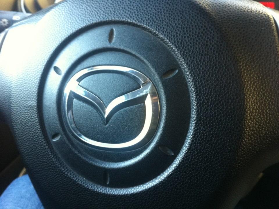 Эмблема на руле